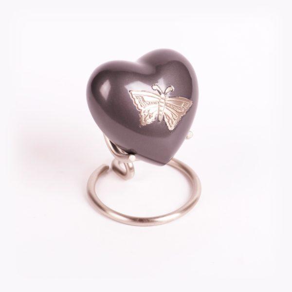 Messing urn hart vlinder